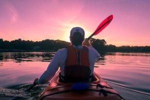 canoeing into sunset - man